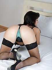 Cute brunette coed Tess wearing only her fishnet stockings.