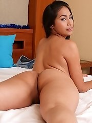 Beautiful Latina Ruth Medina spreads pink pussy lips.