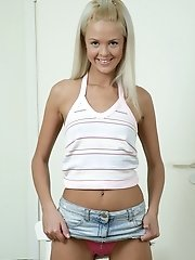 Blonde beauty Faith pulls up her skirt to show off her pink ...